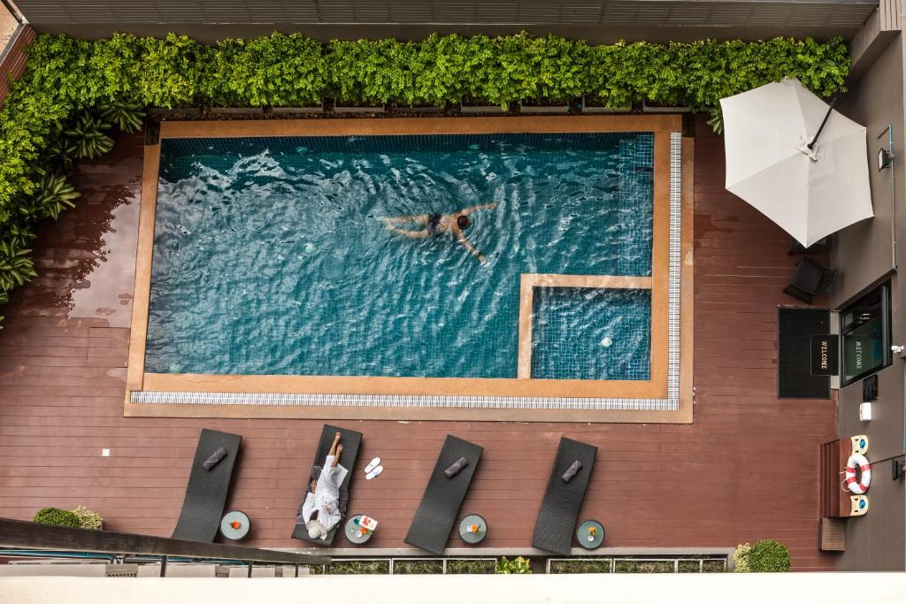 A view of the pool at Cmor Hotel Chiang Mai by Andacura or nearby
