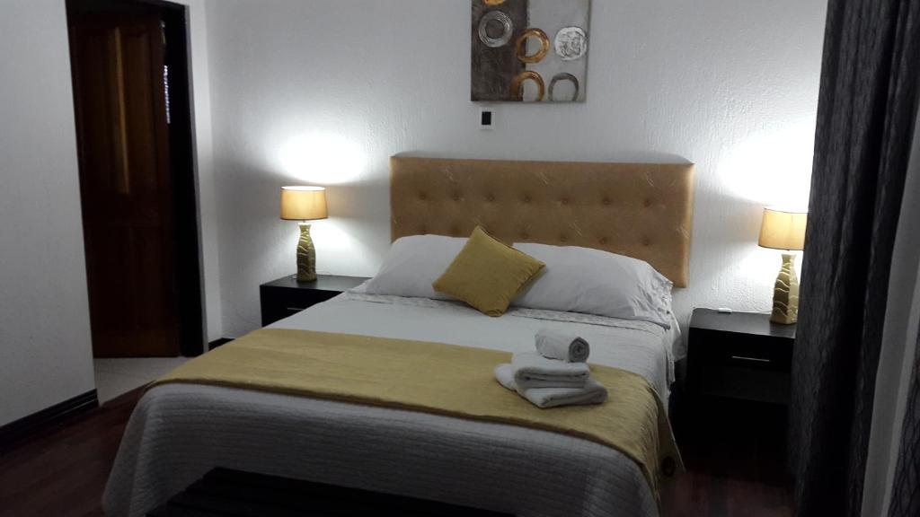 Cama o camas de una habitación en Hotel Dream House Escazú
