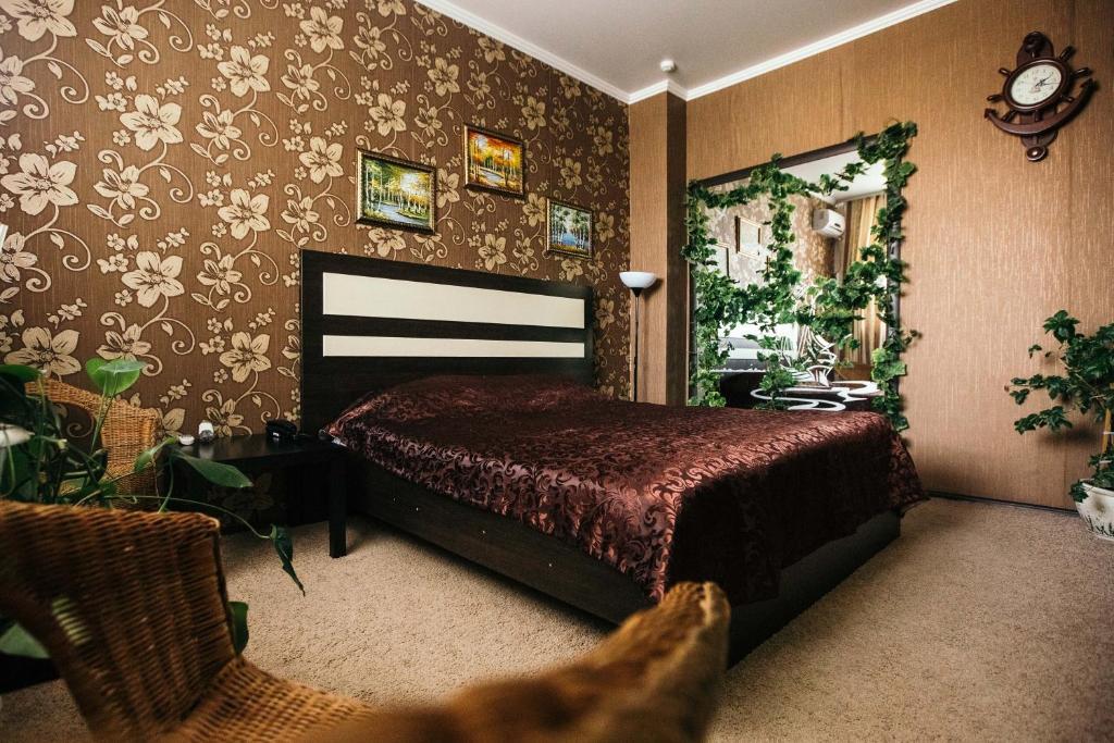 Кровать или кровати в номере Hotel Avrora