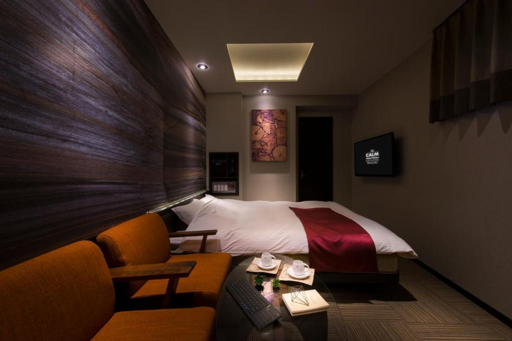 A bed or beds in a room at The CALM Hotel Tokyo (Adult Only)