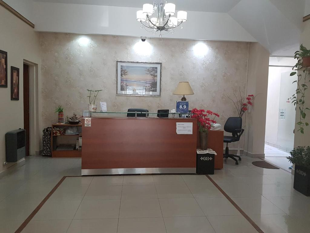 The lobby or reception area at San Carlos Hotel