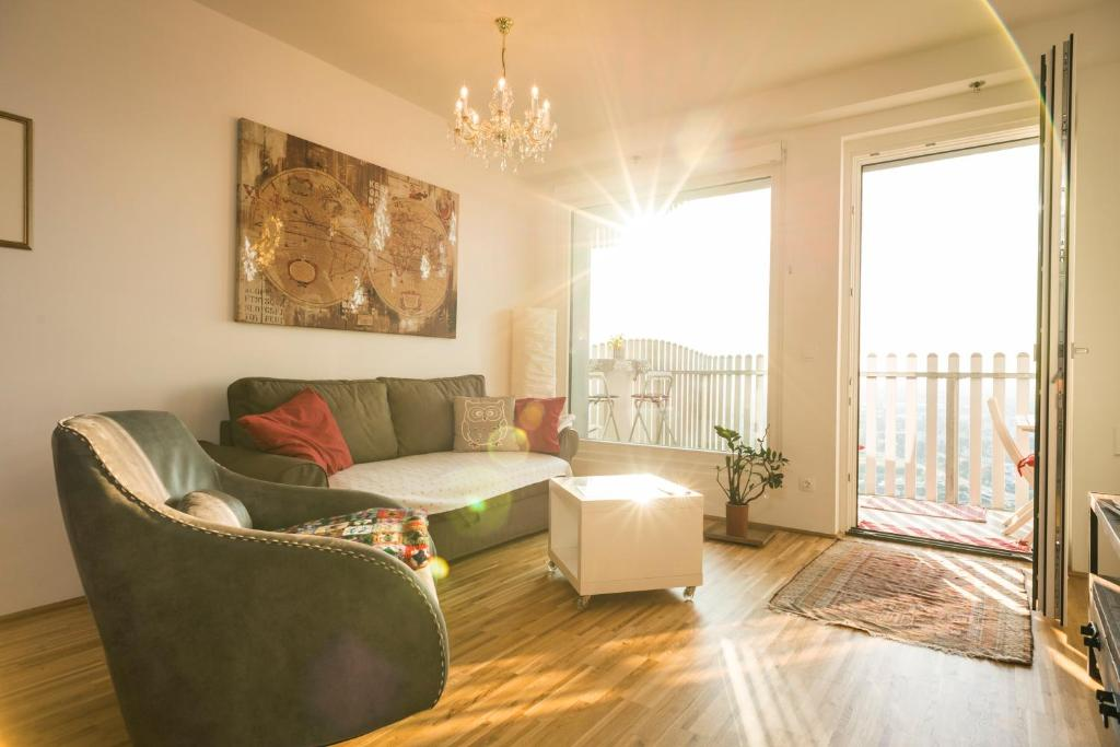 A seating area at Sky View Apartment Vienna by welcome2vienna