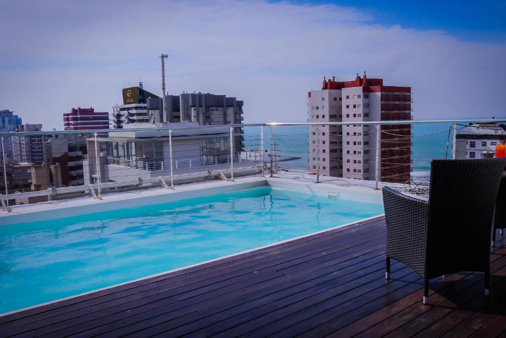 The swimming pool at or near Elegance Hotel