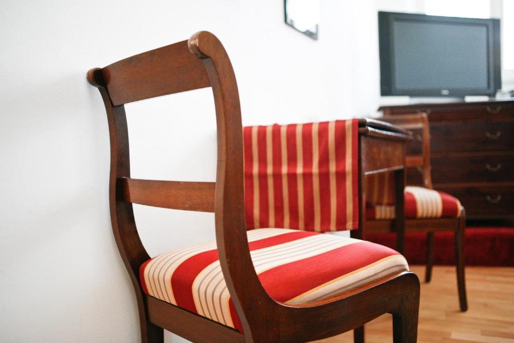 Ein Bett oder Betten in einem Zimmer der Unterkunft Einhornhaus