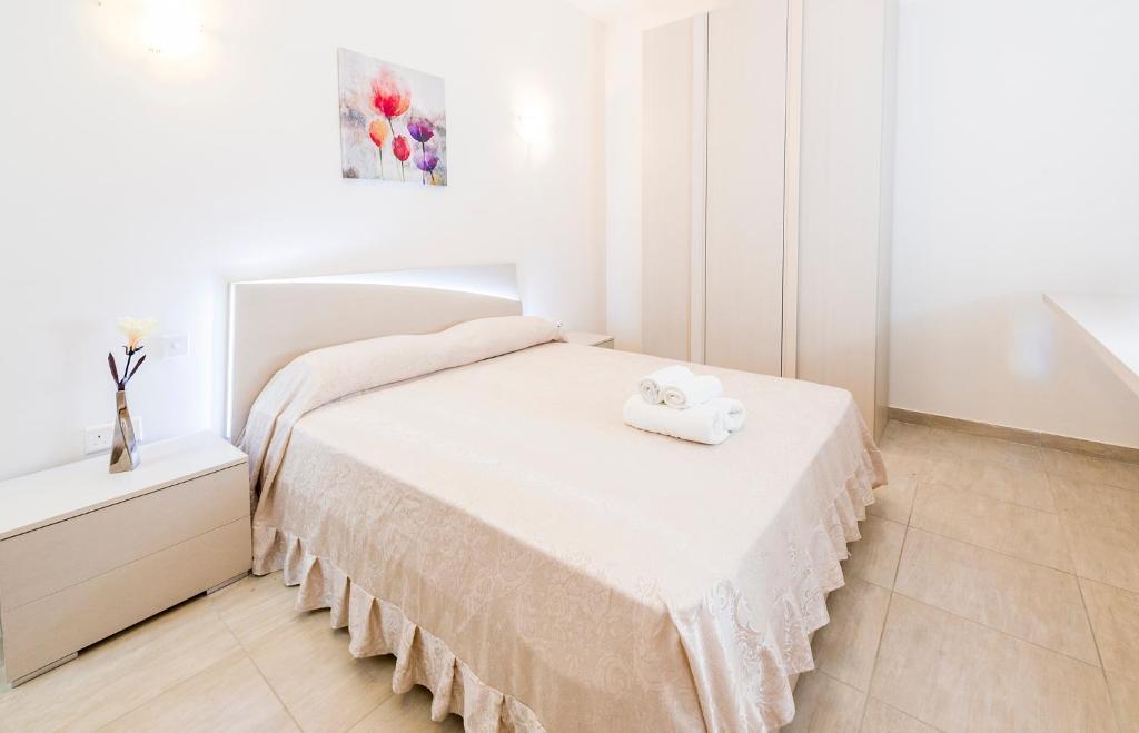 Ein Bett oder Betten in einem Zimmer der Unterkunft Isola del Mar