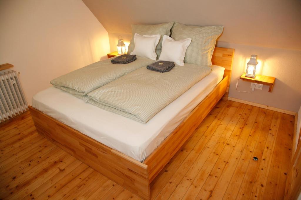 Ein Bett oder Betten in einem Zimmer der Unterkunft Pension der Rotmilan
