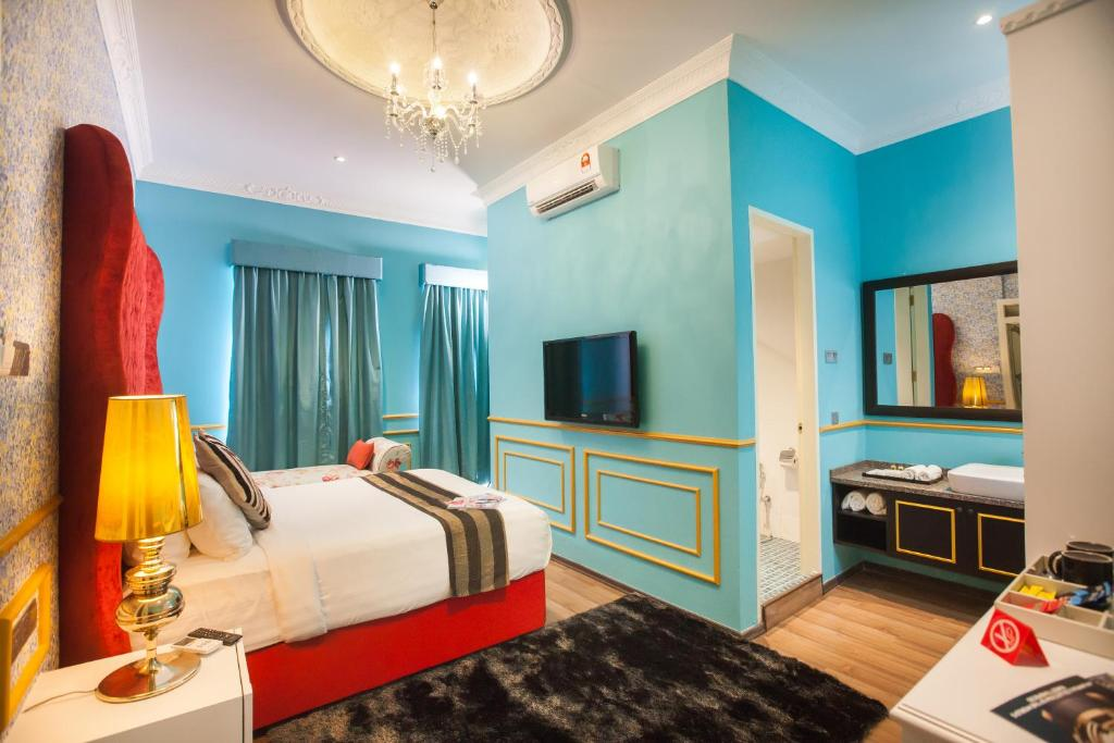 A room at Deluxcious Luxurious Heritage Hotel
