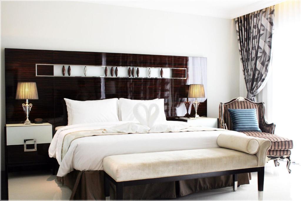 Кровать или кровати в номере LK Royal Wing