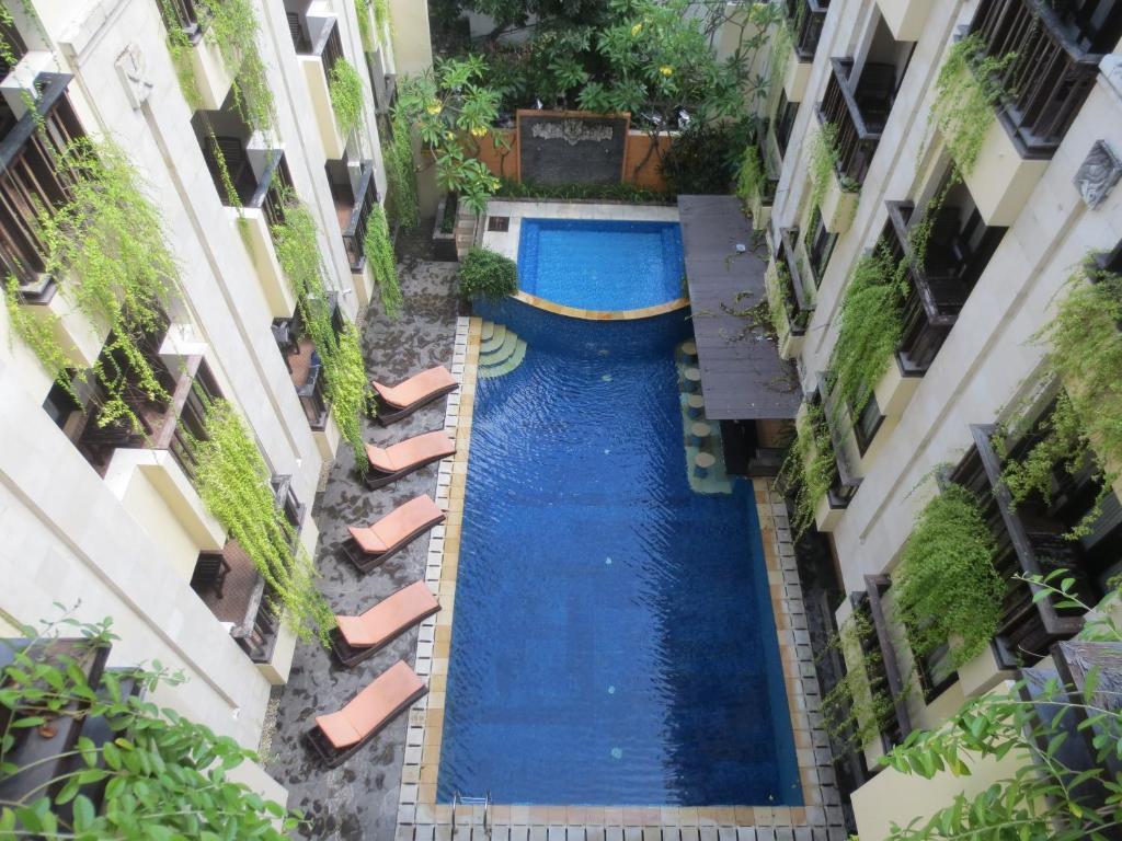 The swimming pool at or near Losari Hotel & Villas Kuta Bali