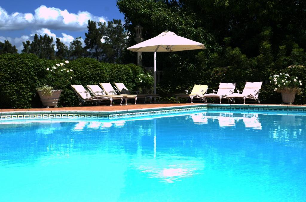 Der Swimmingpool an oder in der Nähe von Clos Malverne Wine Estate