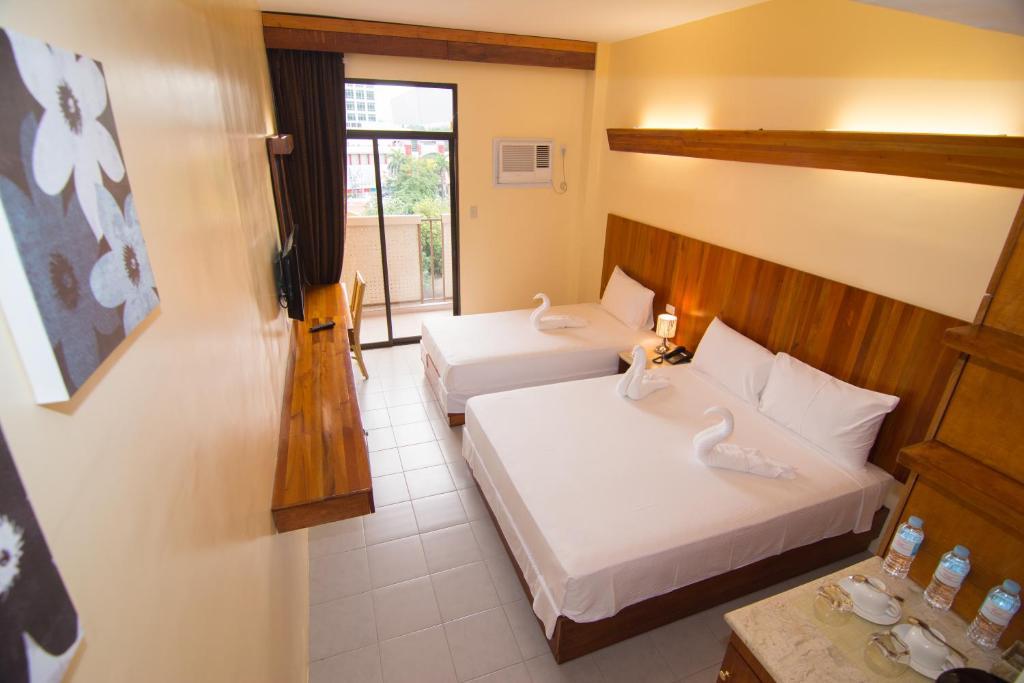 Una habitación de Tsai Hotel and Residences