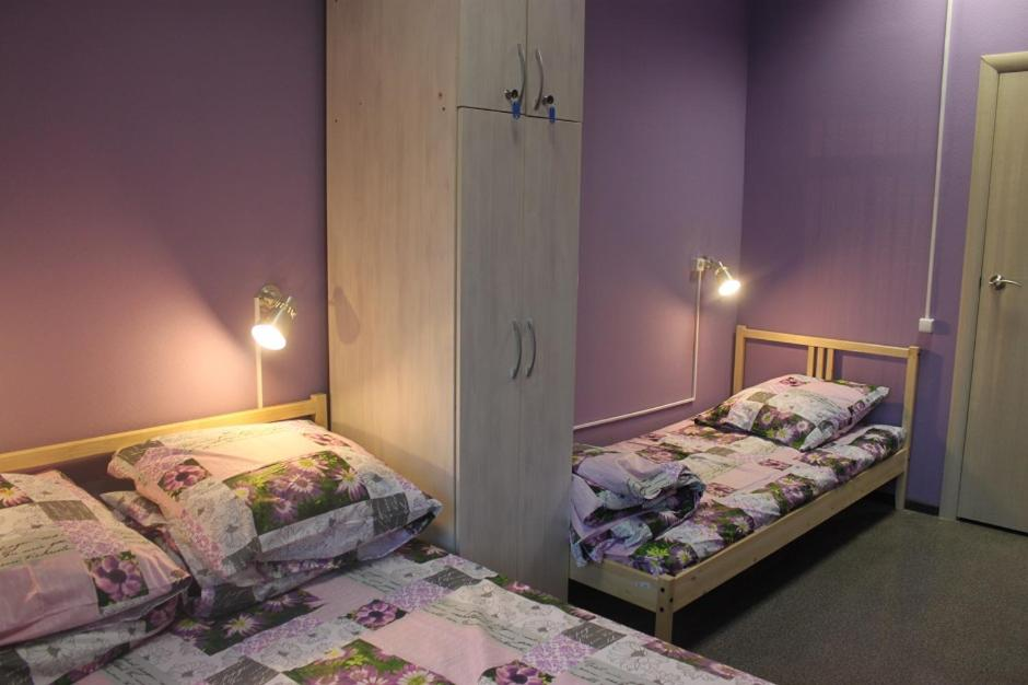 A bed or beds in a room at Hostel Uytnyi
