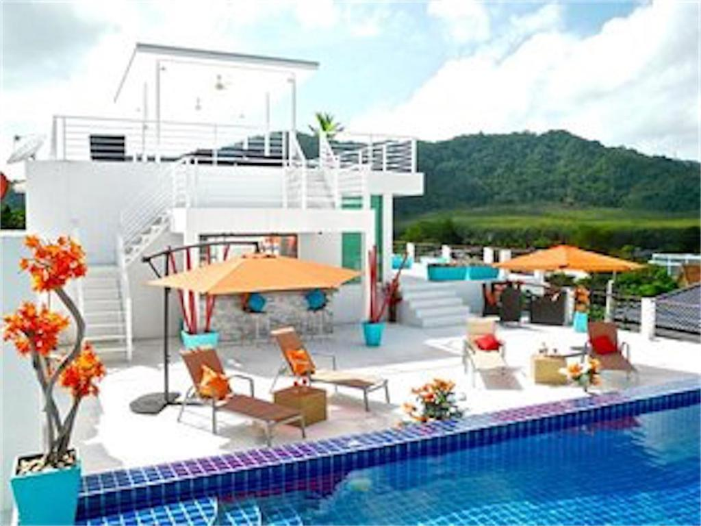 The swimming pool at or near Sunrise 3 bedrooms Modern Apartment In Nai Harn