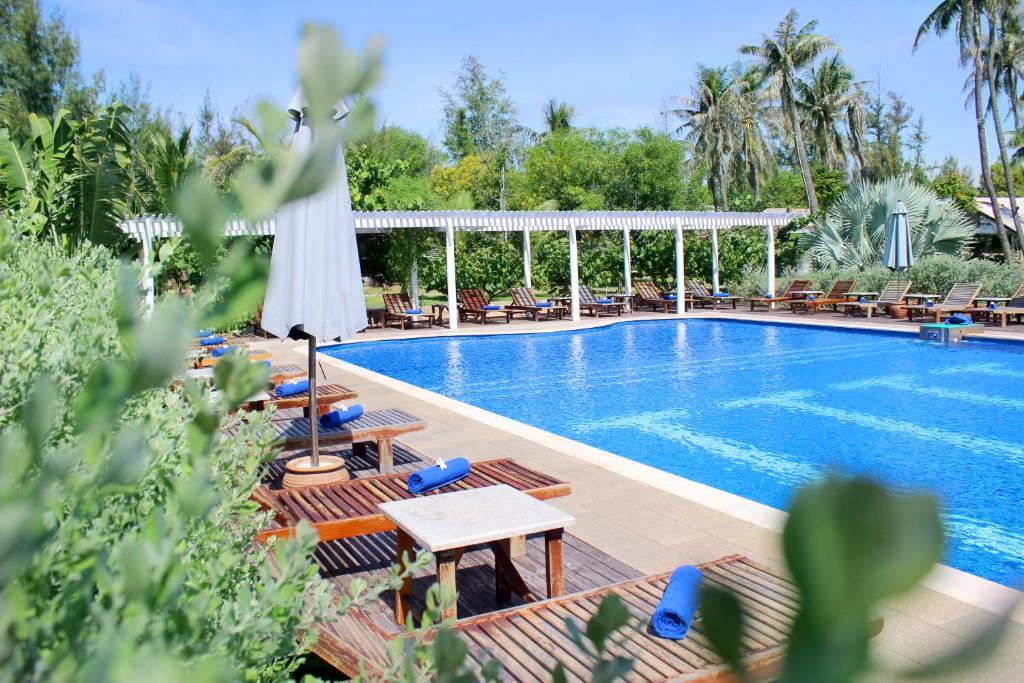 A piscina localizada em Blue Shell Resort ou nos arredores
