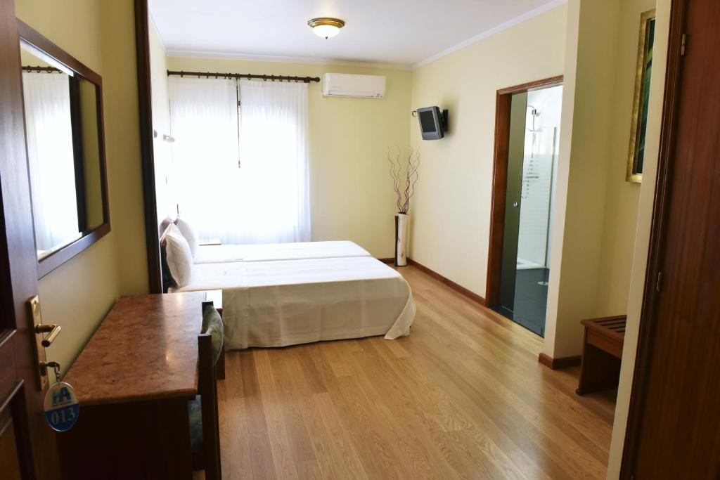 A bed or beds in a room at Hotel Aeroporto