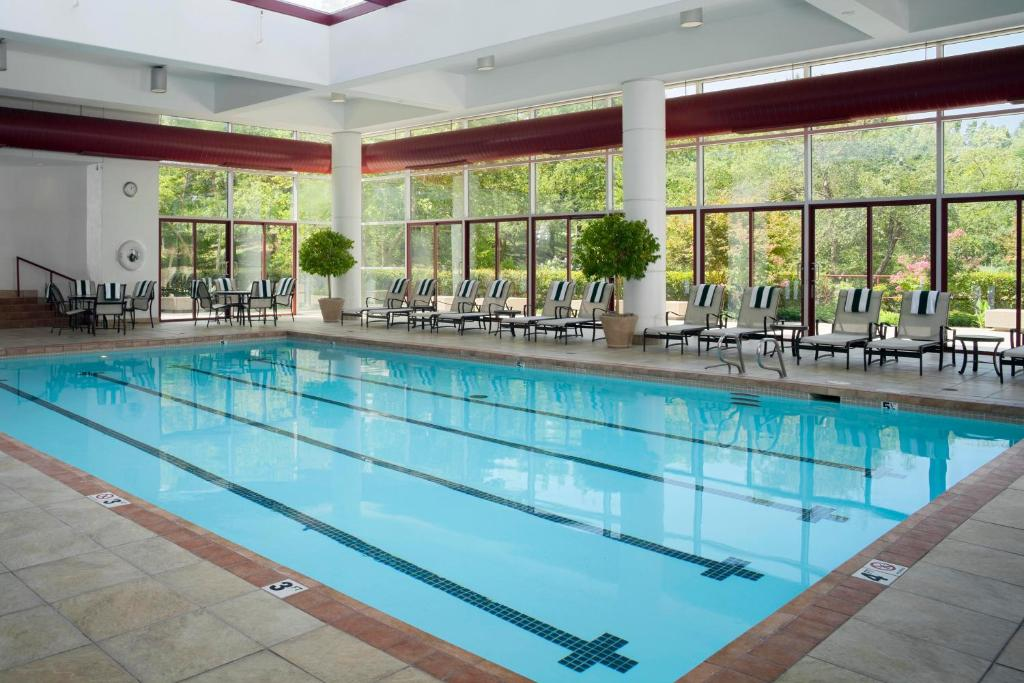 The swimming pool at or near DoubleTree by Hilton Tulsa at Warren Place