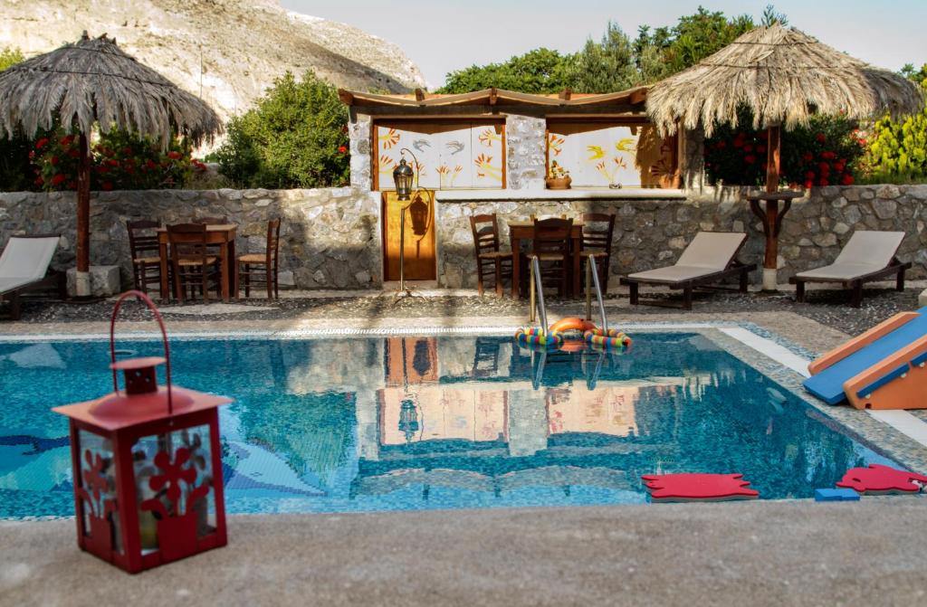 The swimming pool at or near Birds Villa Apartments - Including Car Rental