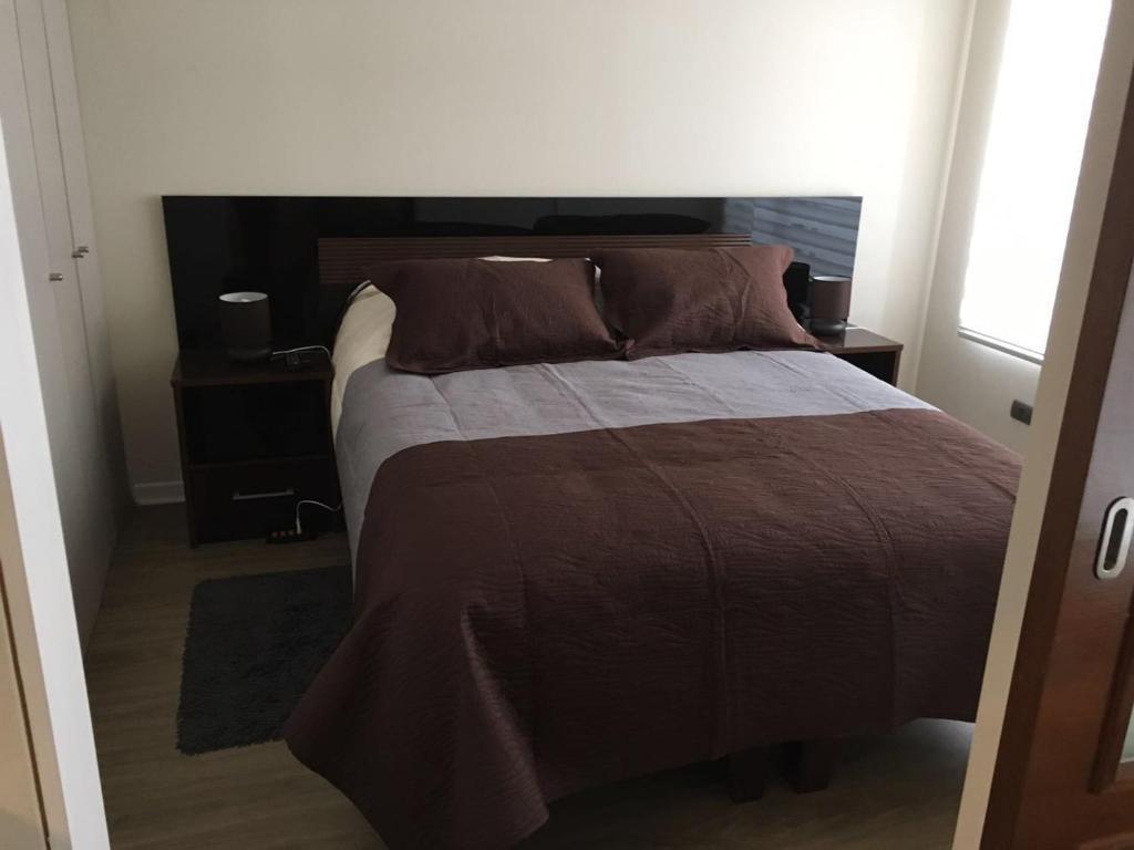 Cama o camas de una habitación en Santiago Bus Terminal