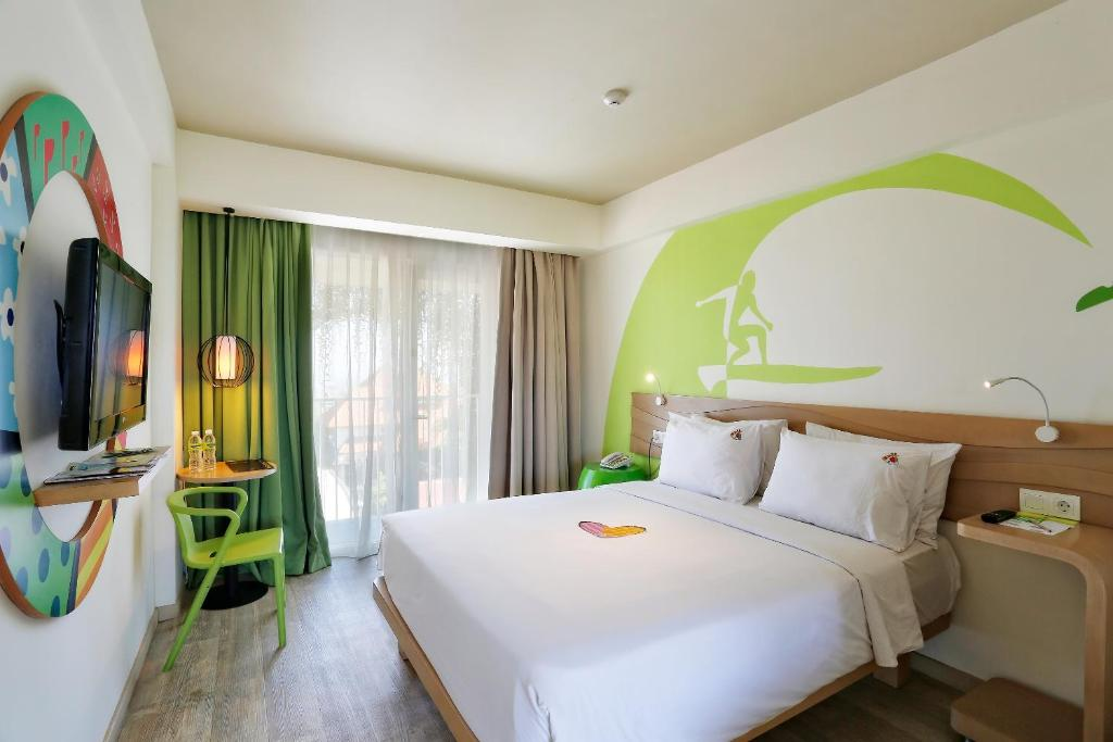 A bed or beds in a room at MaxOneHotels at Bukit Jimbaran
