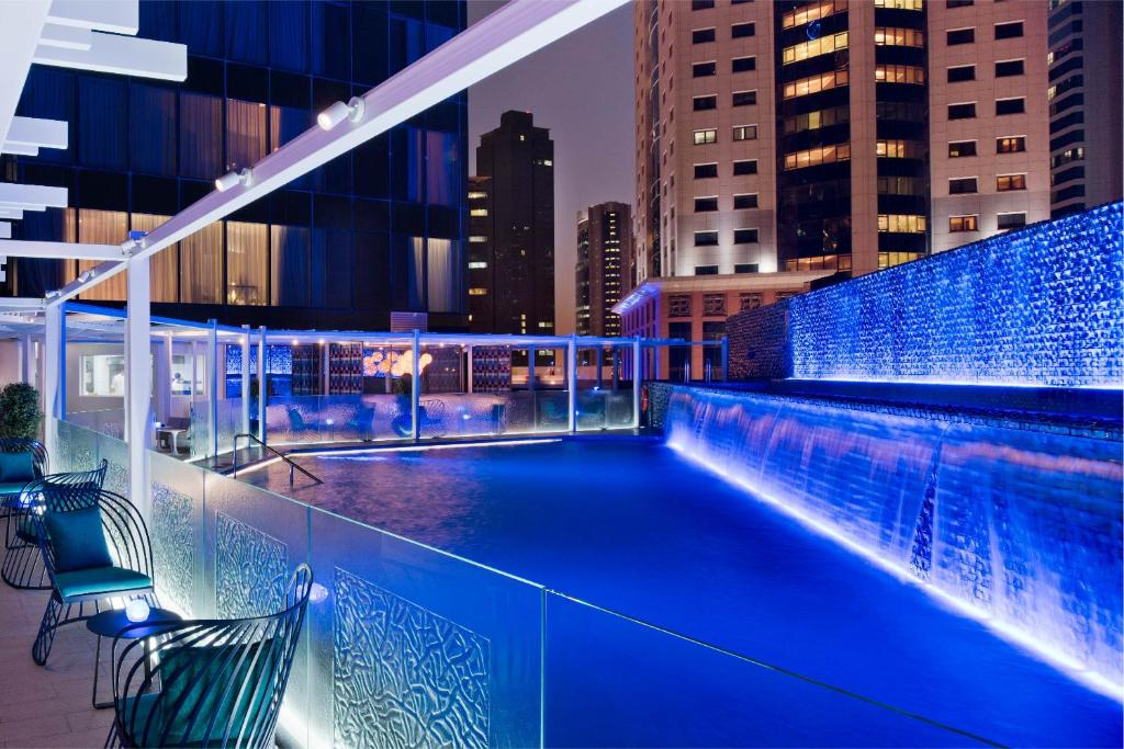 The swimming pool at or near W Doha