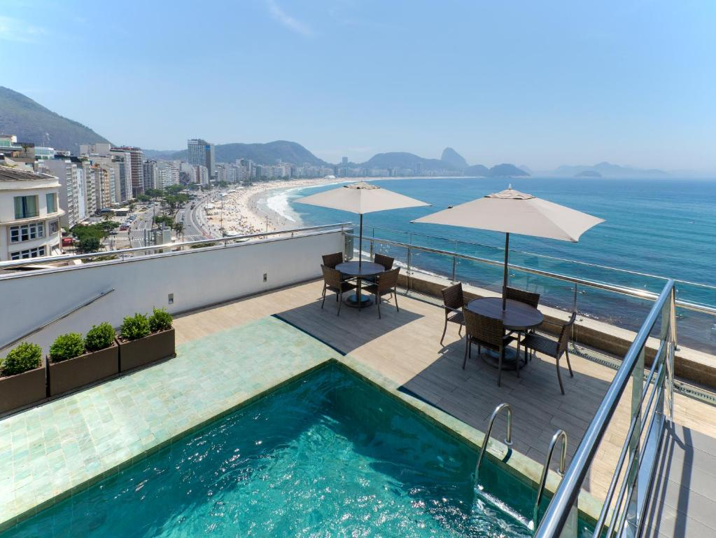 The swimming pool at or near Orla Copacabana Hotel