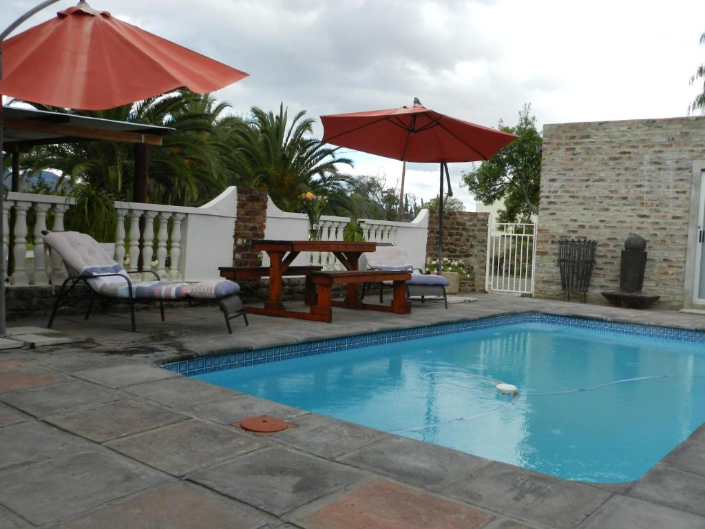 The swimming pool at or near A Mountain View Guesthouse