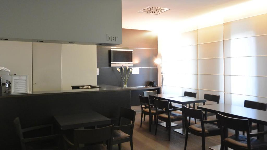 The lounge or bar area at Hotel Corallo