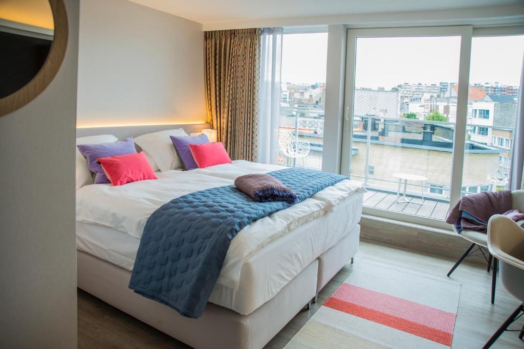 Ein Bett oder Betten in einem Zimmer der Unterkunft ABC Hotel