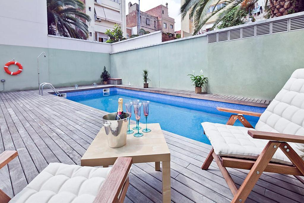 The swimming pool at or near Apartment Barcelona Rentals - Gracia Pool Apartments Center