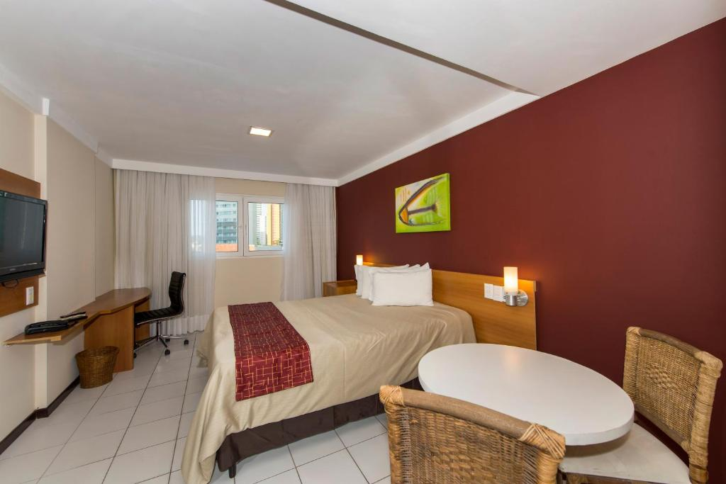 A bed or beds in a room at Red Roof Inn Natal