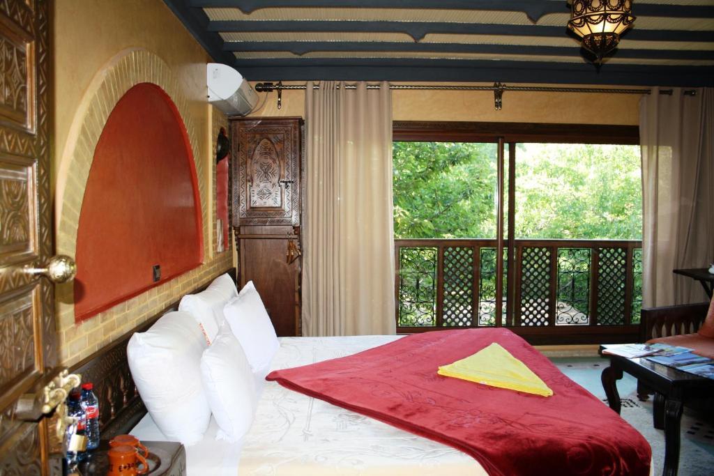 Ein Bett oder Betten in einem Zimmer der Unterkunft Riad Jnane Imlil