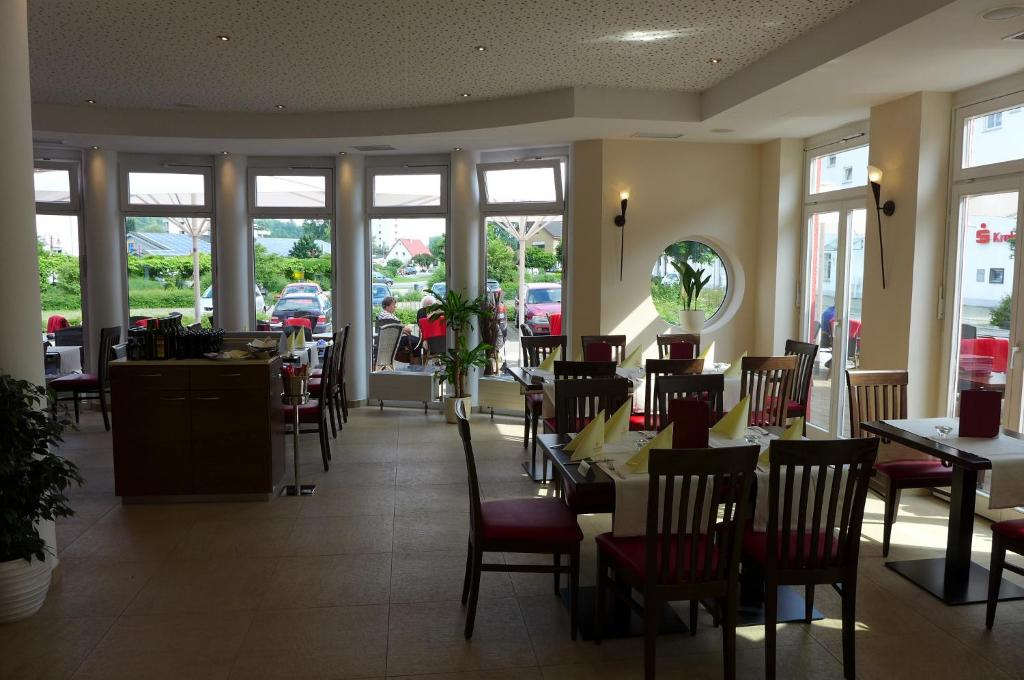 Ein Restaurant oder anderes Speiselokal in der Unterkunft Hotel & Ristorante Passarelli