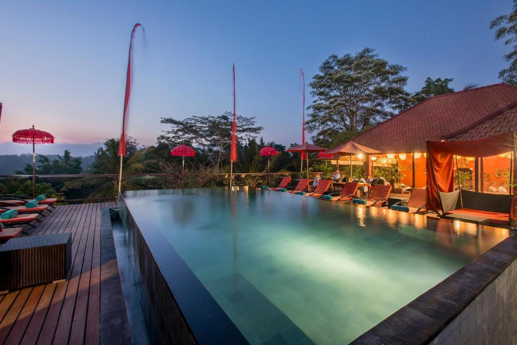The swimming pool at or close to Jungle Retreat by Kupu Kupu Barong