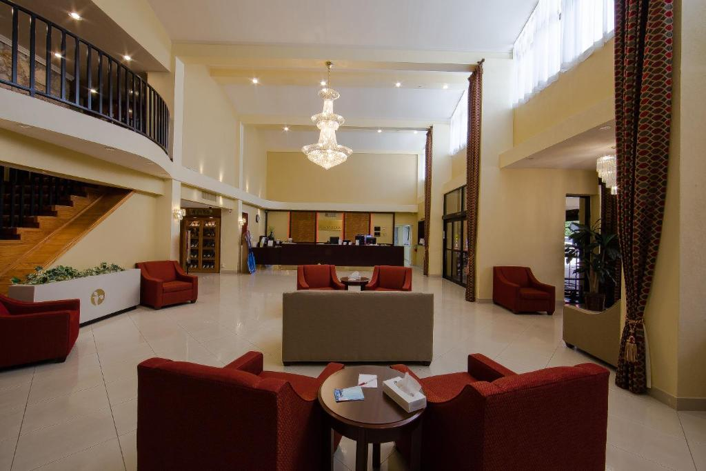 The lobby or reception area at Ramada by Wyndham Houston Intercontinental Airport East
