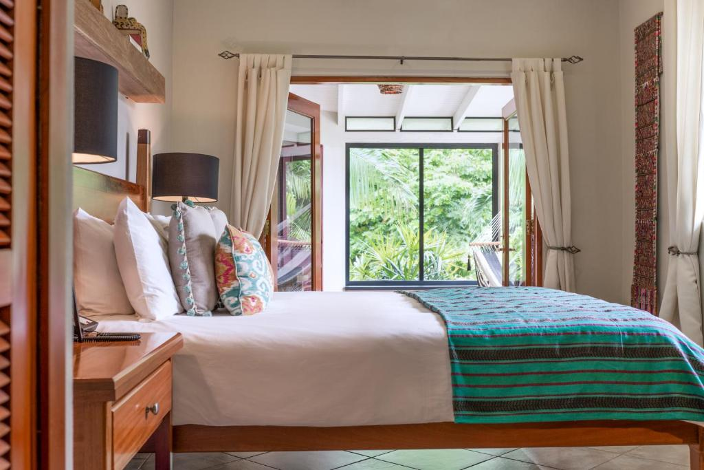 A bed or beds in a room at Ka'ana Resort & Spa