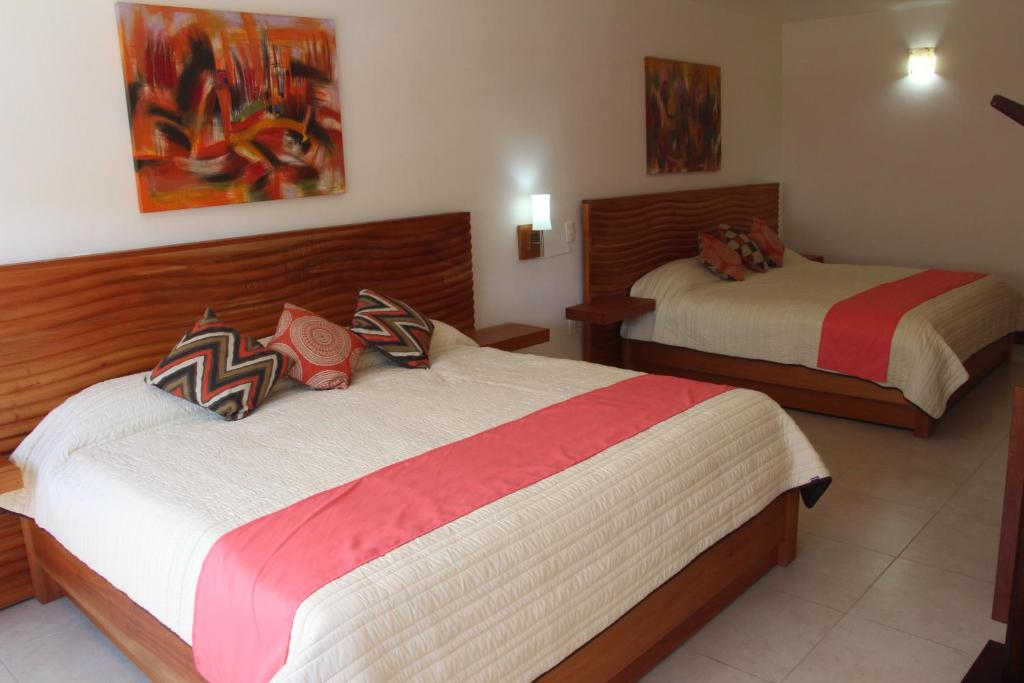 A bed or beds in a room at Hotel Galeria