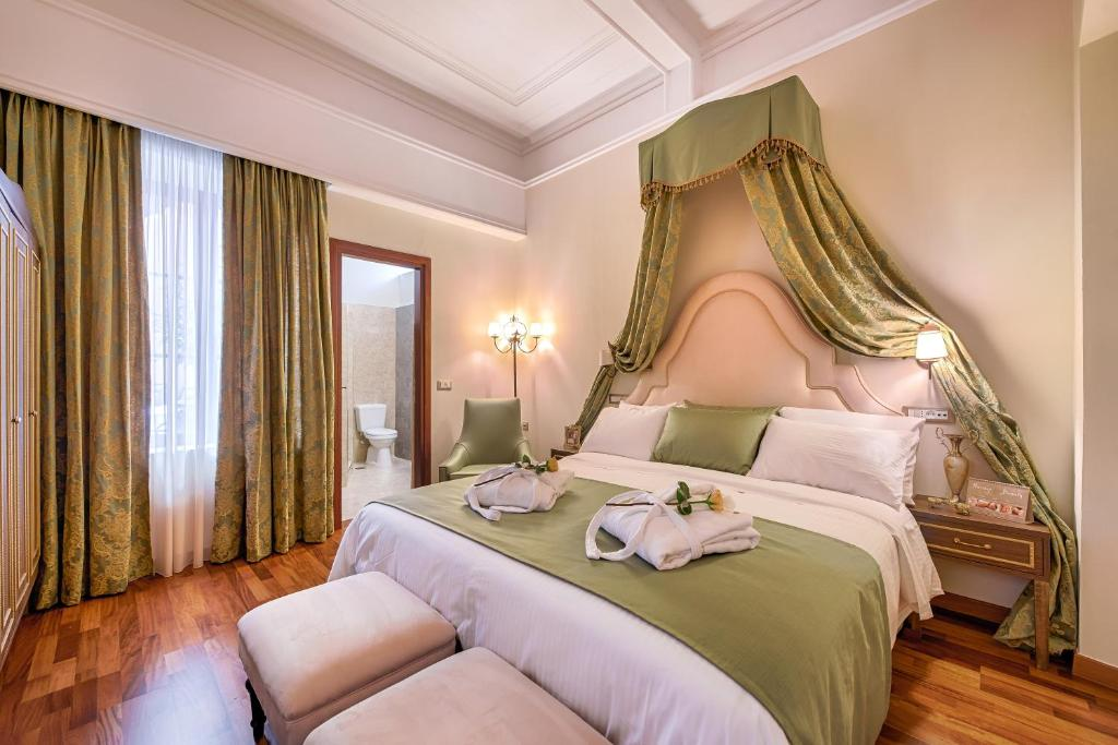 A bed or beds in a room at Sperveri Boutique Hotel