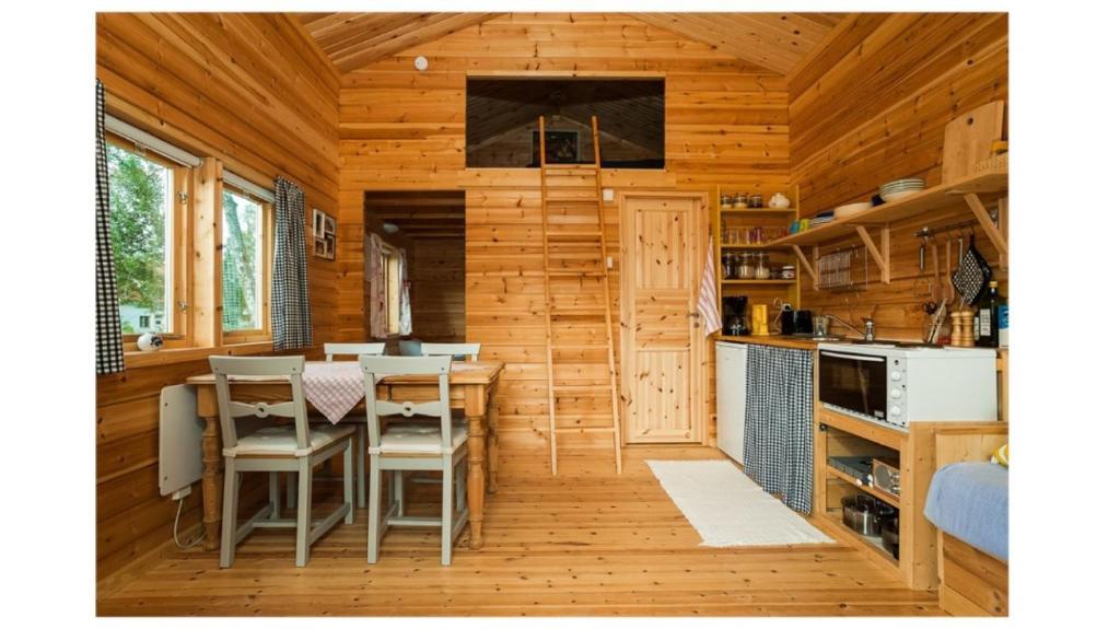 The lounge or bar area at Prostgårdsvägen 11 Cabin