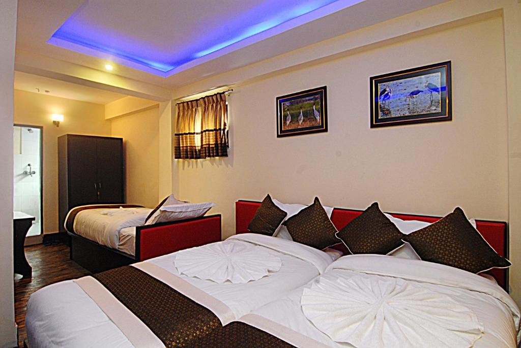 A bed or beds in a room at Hotel Gallery Nepal