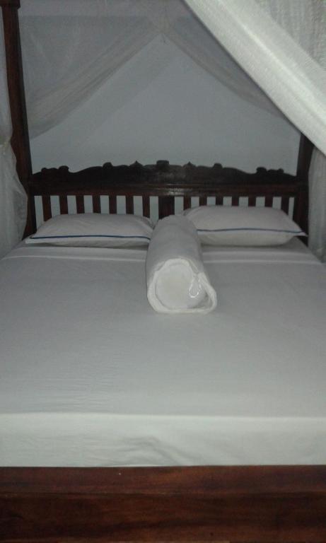 Una habitación en Kadek Homestay