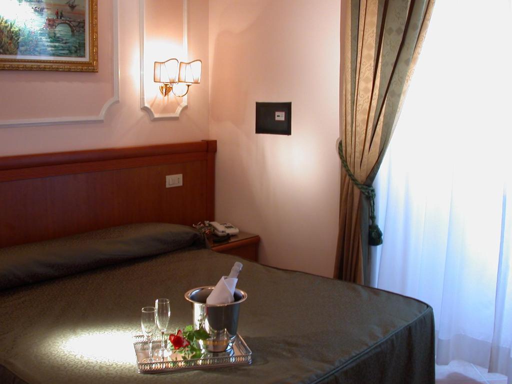 Кровать или кровати в номере Hotel Philia