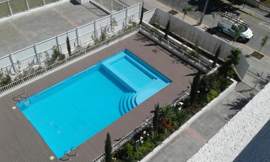 Vista de la piscina de Teo Gandolfo Apart o alrededores