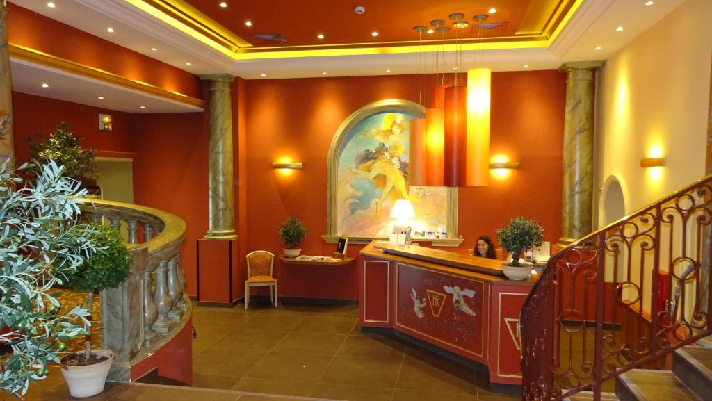 The lobby or reception area at Hôtel Régence