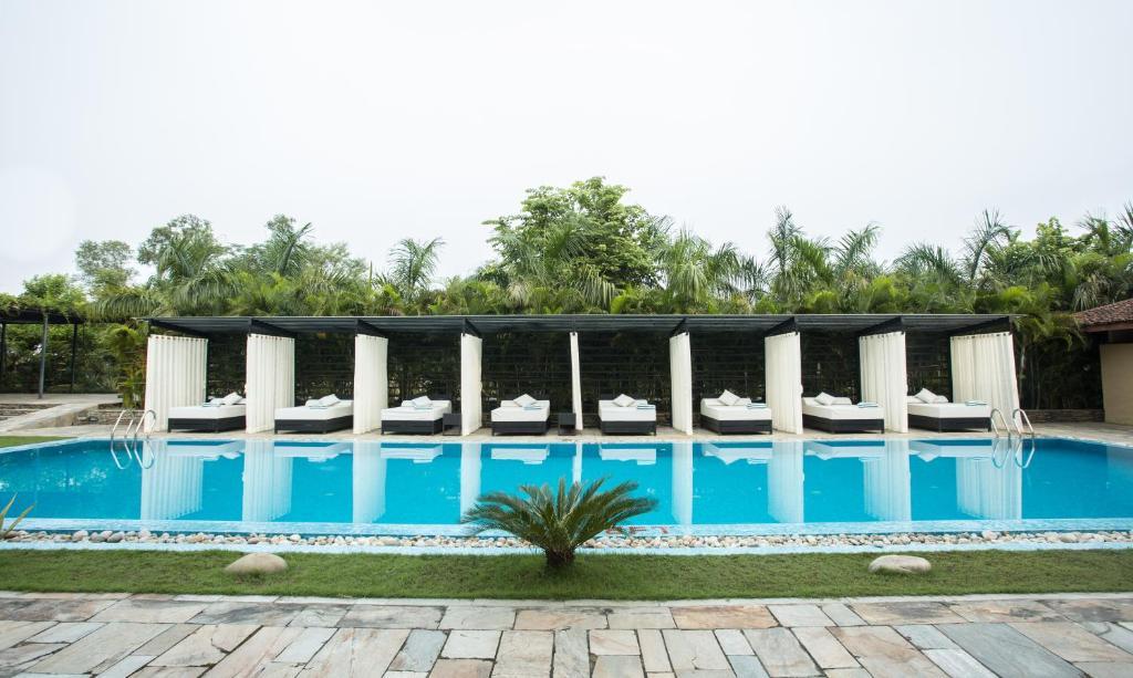 The swimming pool at or near Kasara Resort Chitwan National Park
