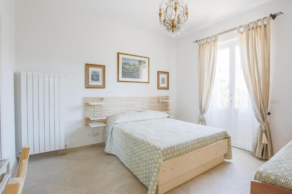 A bed or beds in a room at B&B Fior Fiore