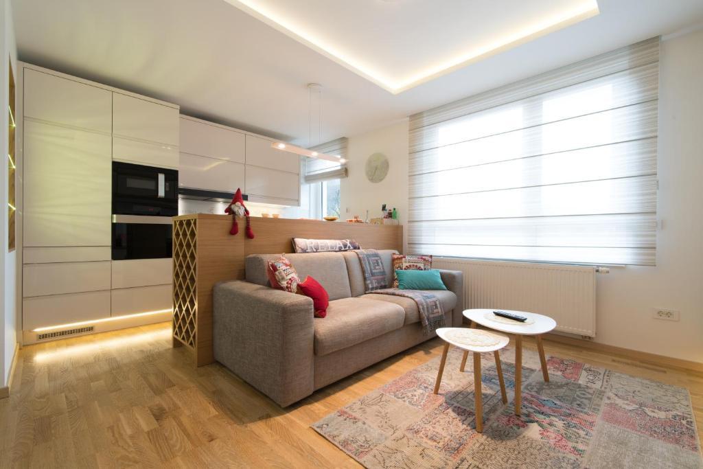 Zona de lounge sau bar la LikeHome Apartment Aida