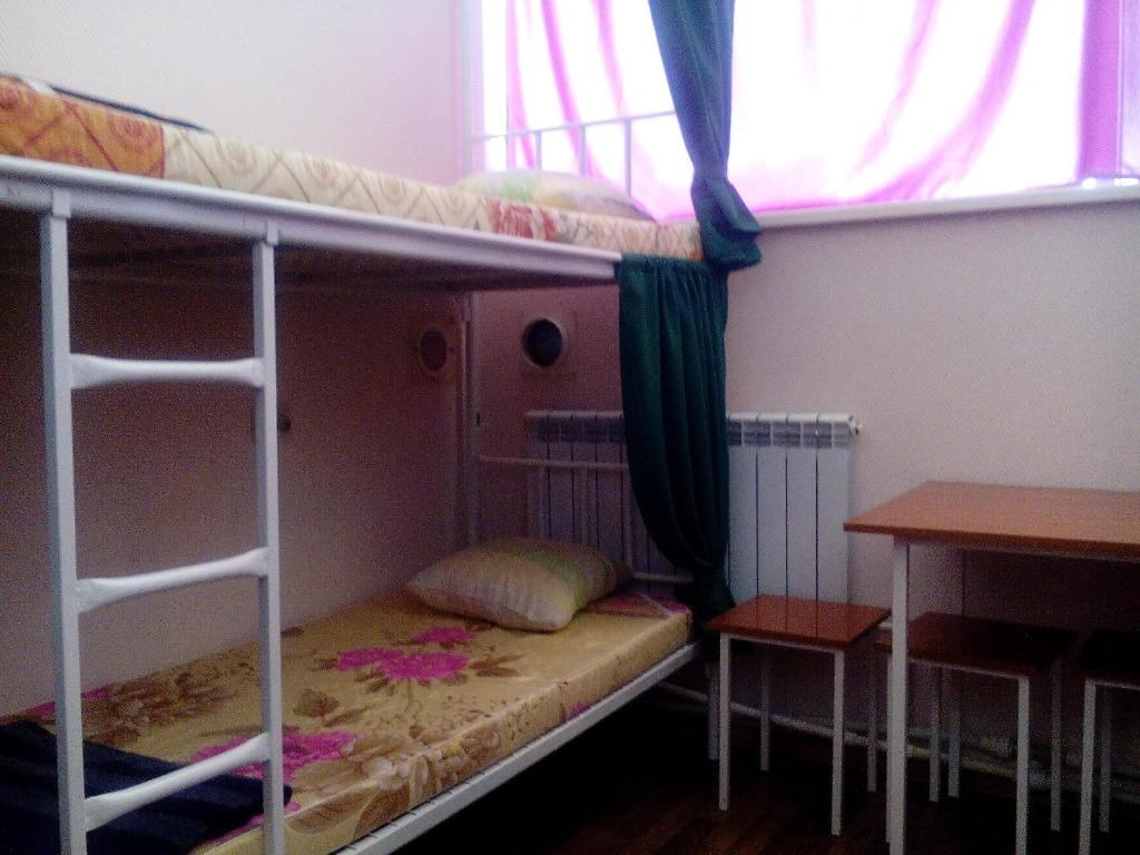 A bunk bed or bunk beds in a room at Hostel Uyut