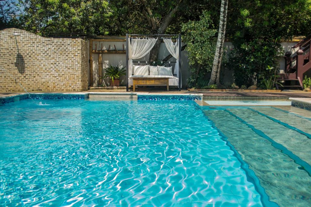 The swimming pool at or close to Pousada Blue Marlin