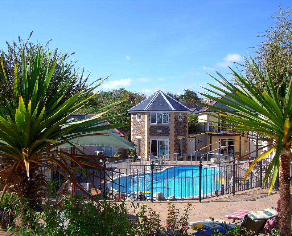 The swimming pool at or near Porth Veor Manor Villas & Apartments