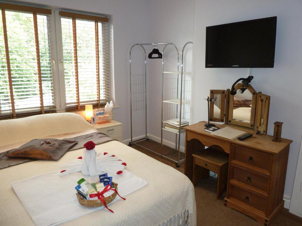 A bed or beds in a room at The Crescent Homestay